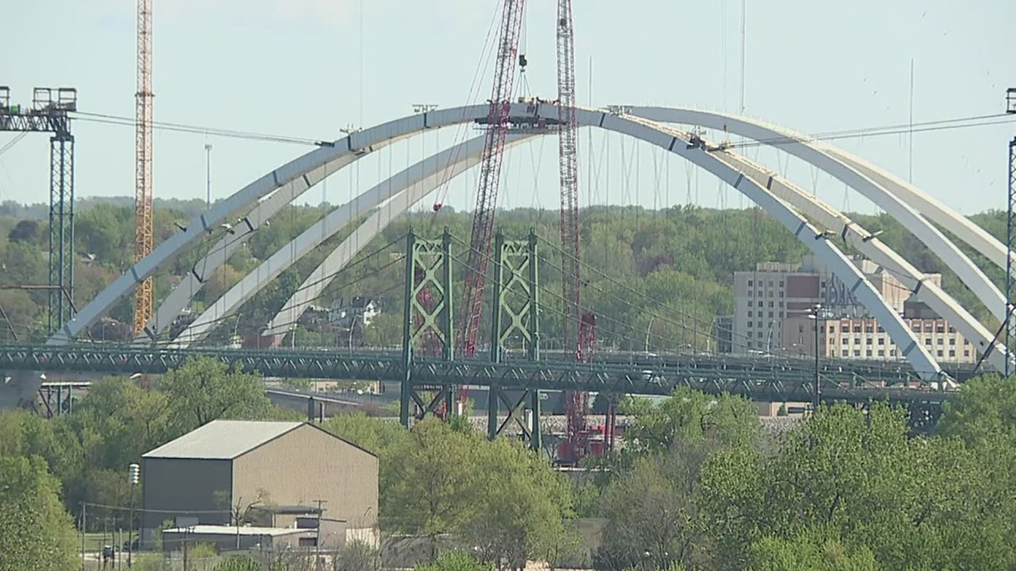 Group in Moline watch bridge project from apartment balcony