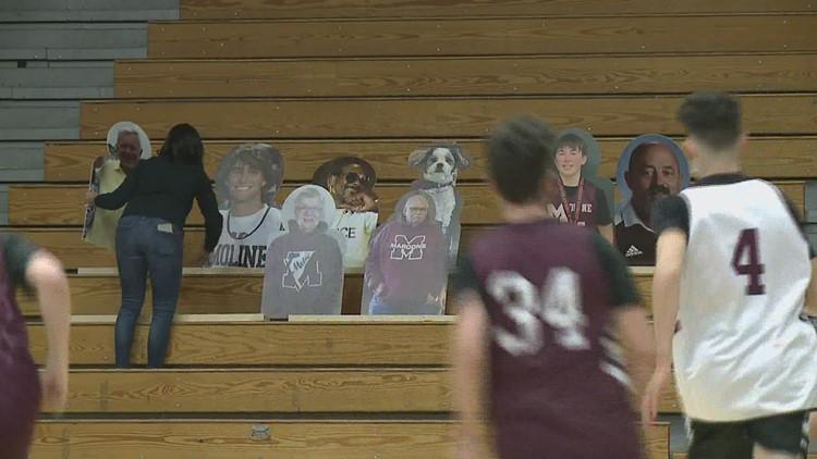 Moline High School filling the bleachers with cardboard cutout fans