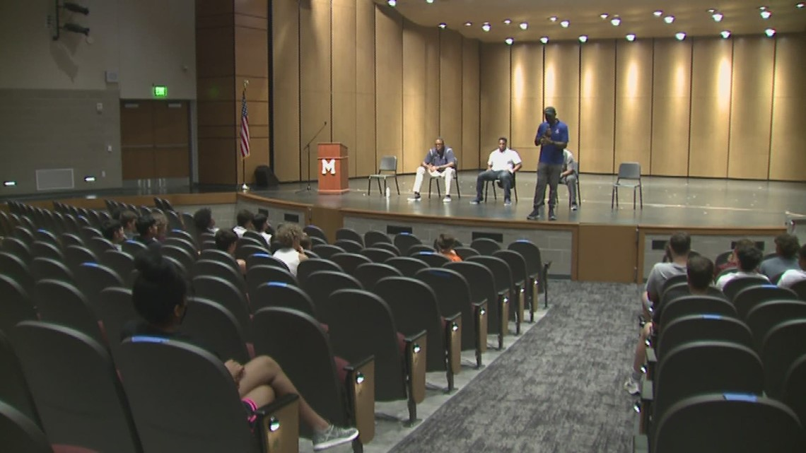 Moline Football Players learn life lessons from former NFL Players