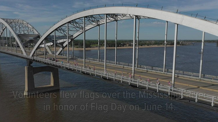 Watch: Dozens of American flags line the Quad Cities' Centennial Bridge for Flag Day
