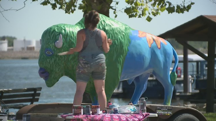 Life sized bison painting to travel around Quad Cities in support of the Bison Bridge