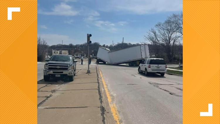 Semi collapsed, blocked 23rd Street in Moline