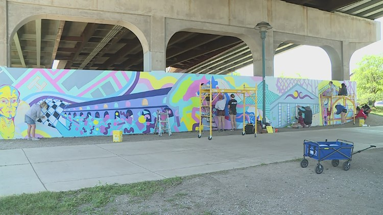 Mural inspired by QC history pops up along bike path in Moline
