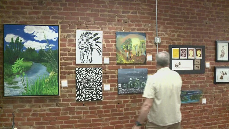 Muscatine art gallery hosts dad art and dad jokes