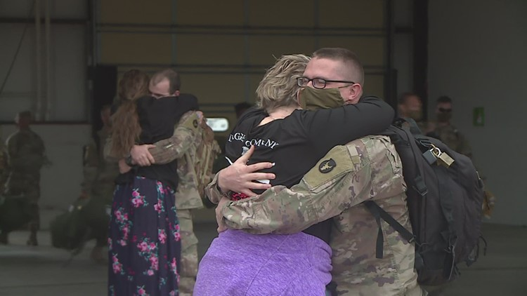 Families reunite with National Guard members returning from service overseas