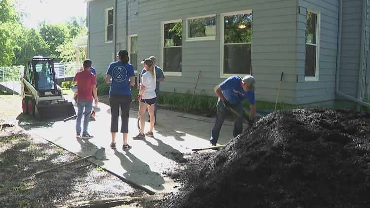 Mel Foster staff donates volunteer hours to OneEighty in Davenport