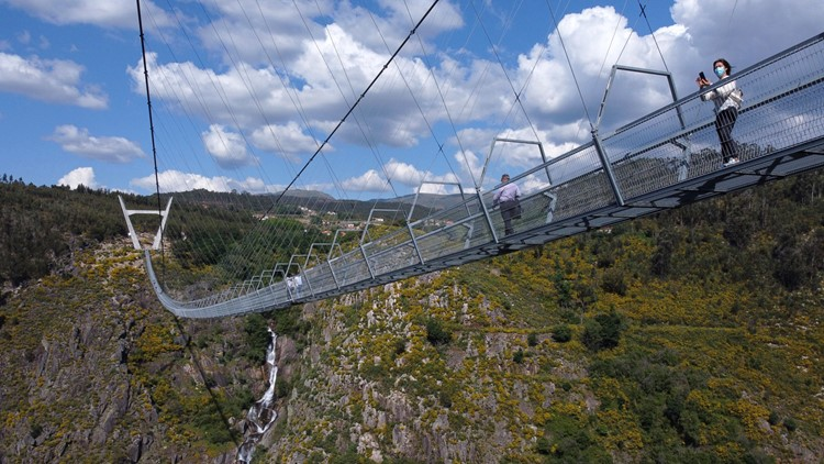 Don't look down: World's longest pedestrian suspension bridge opens 570 feet over Portugal river