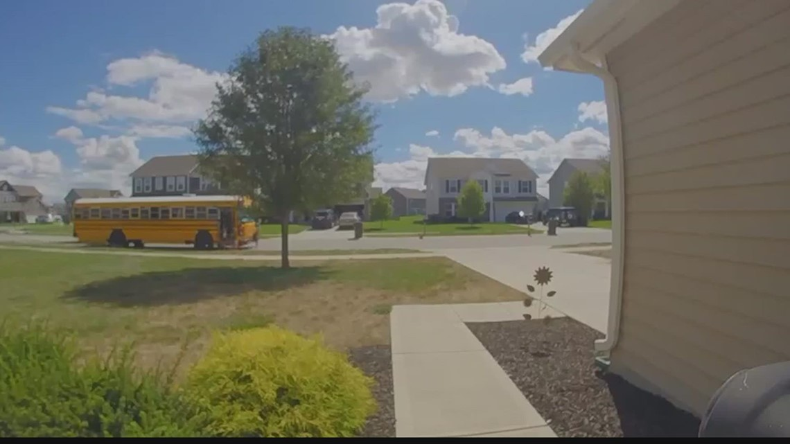 Delivery truck driver charged after nearly hitting children leaving school bus