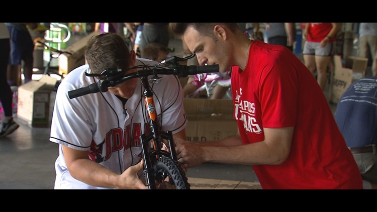 Indians players, volunteers put together bikes for local foster kids