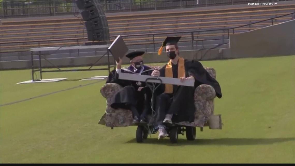 Mitch Daniels makes an unforgettable entrance at Purdue graduation