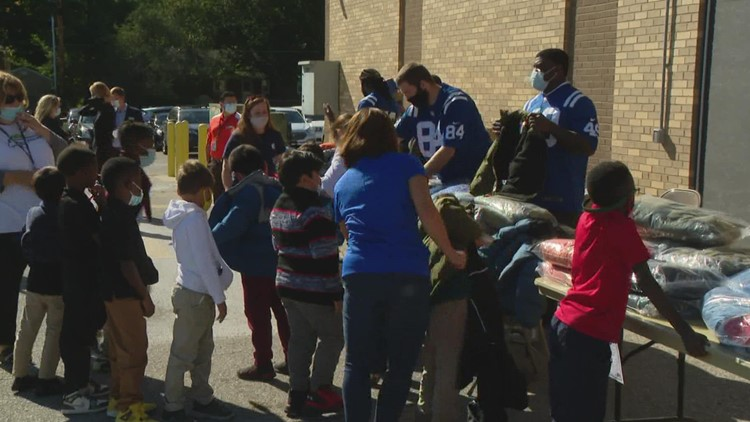 Colts players help at coat giveaway at Indianapolis school