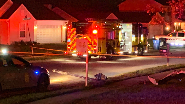 Car goes airborne, crashes into home on Indy's northwest side