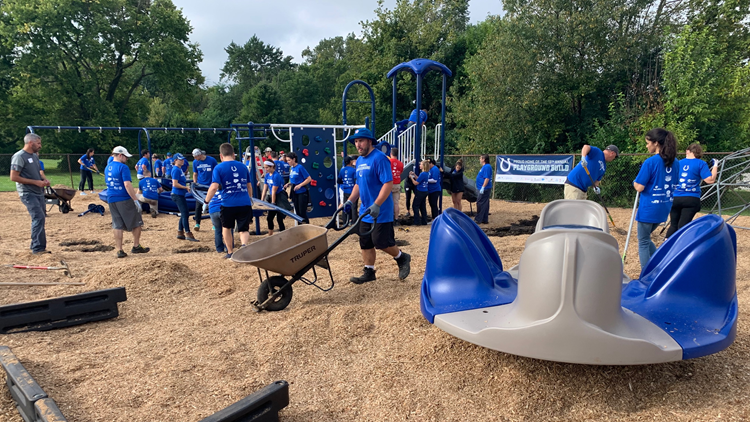 Colts players help build playground at IPS elementary school
