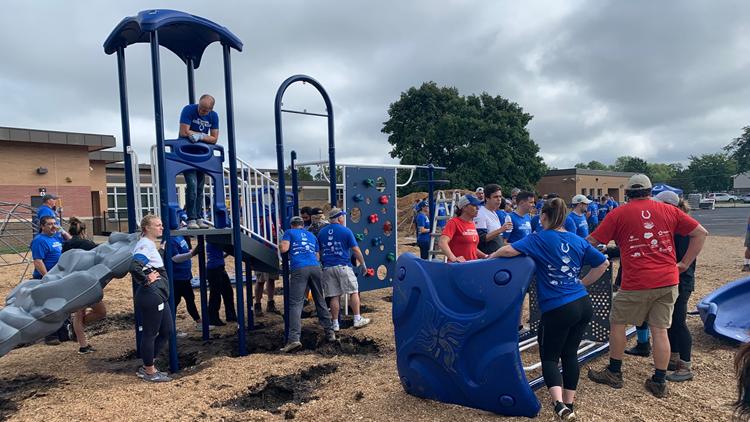 Colts help build school playground