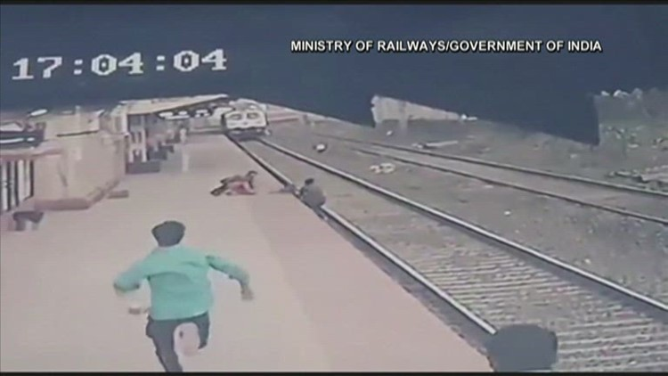 WATCH: Indian railway worker rescues child moments before train zips by