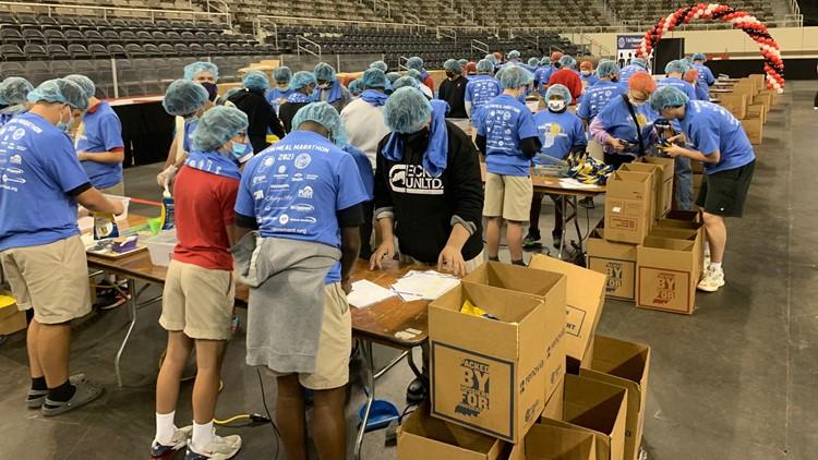 Volunteers work to pack meals for hungry Hoosiers