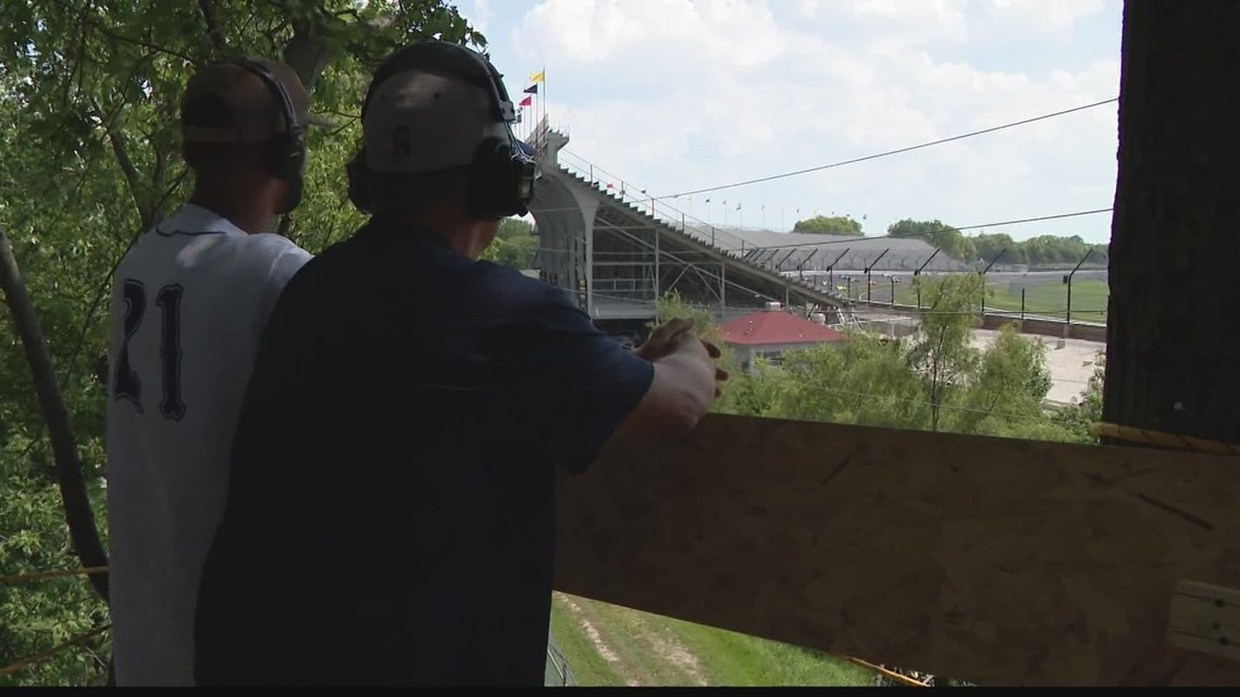 Indy 500 fan watches race from treetop