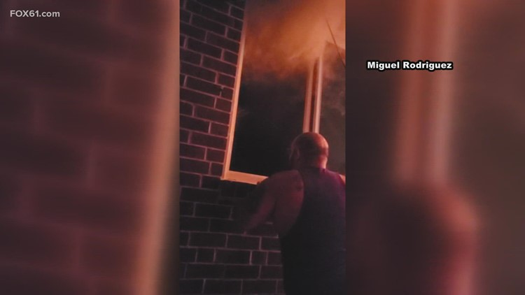 Couple helps man out of burning building