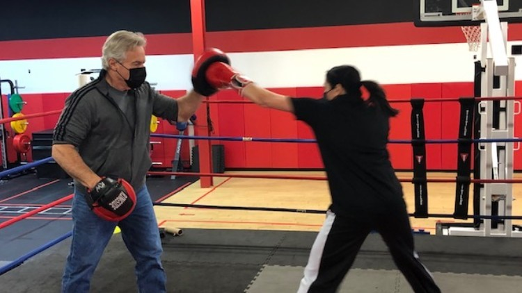 The Frontline Fight: Surgical technician battles the pandemic – in the hospital and the boxing ring