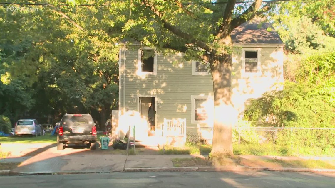 Woman caught after jumping from burning home in New Haven