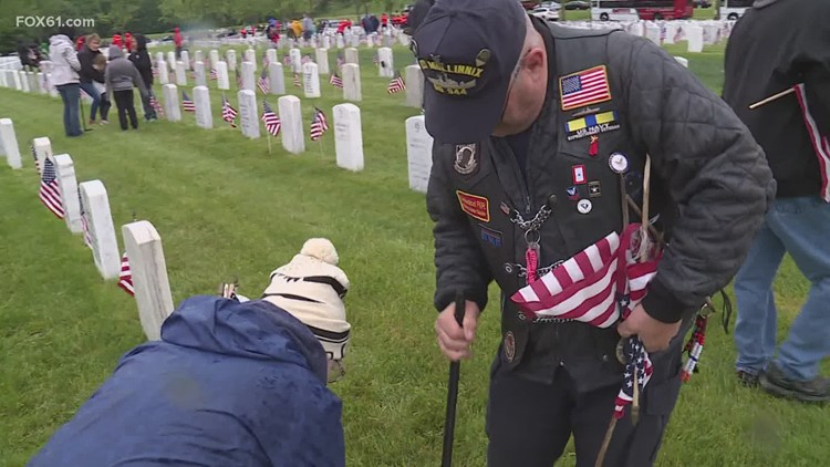 Volunteers plant thousands of flags at CT State Veterans Cemetery