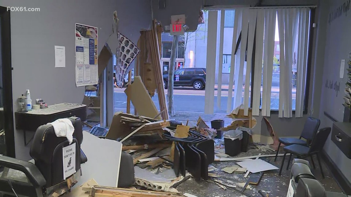 Car slams into New Britain business, owner speaks on the damage done