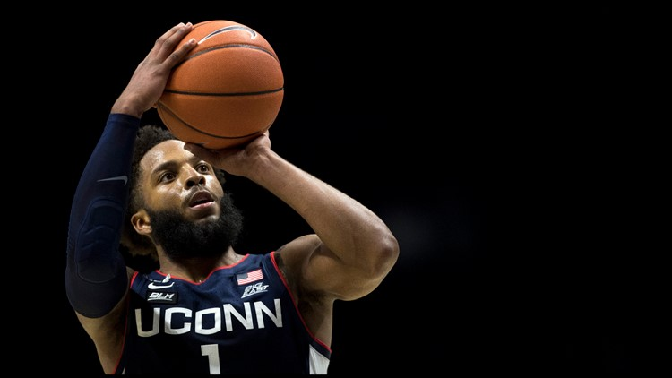 Cole scores season-high 24 to lead UConn over Xavier 80-72