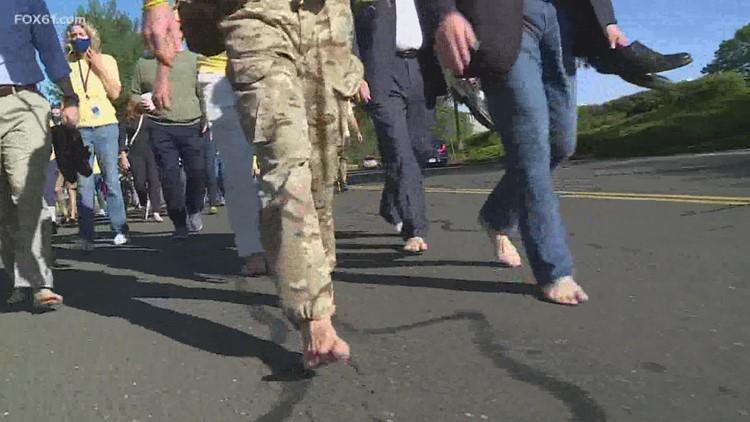 Dad stops in Farmington on 1,200-mile barefoot walk to raising awareness for daughter's rare disorder