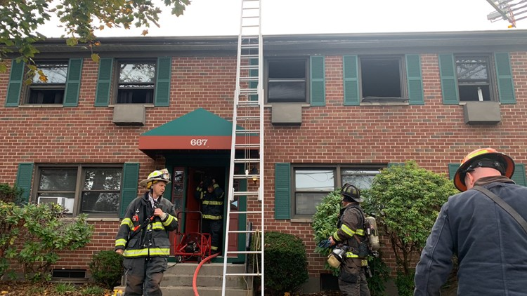 Hamden fire crews rescue 2 from apartment building fire