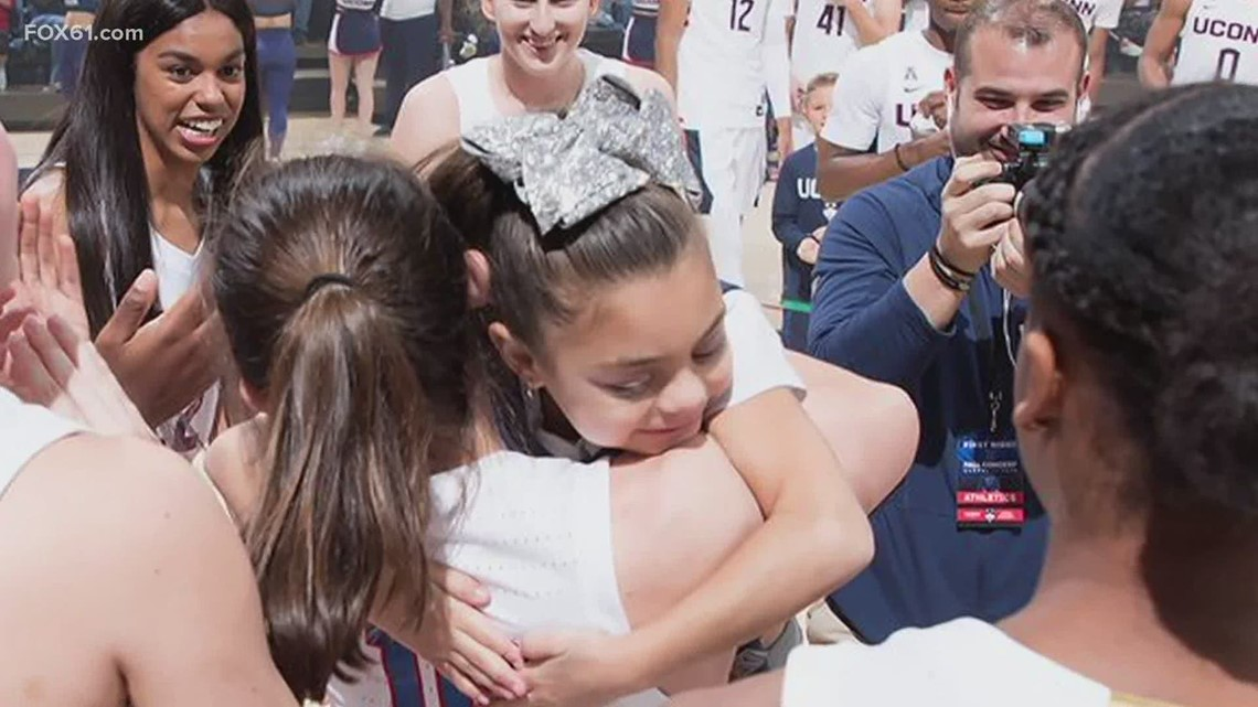 UConn women's basketball team's youngest teammate cheers them on