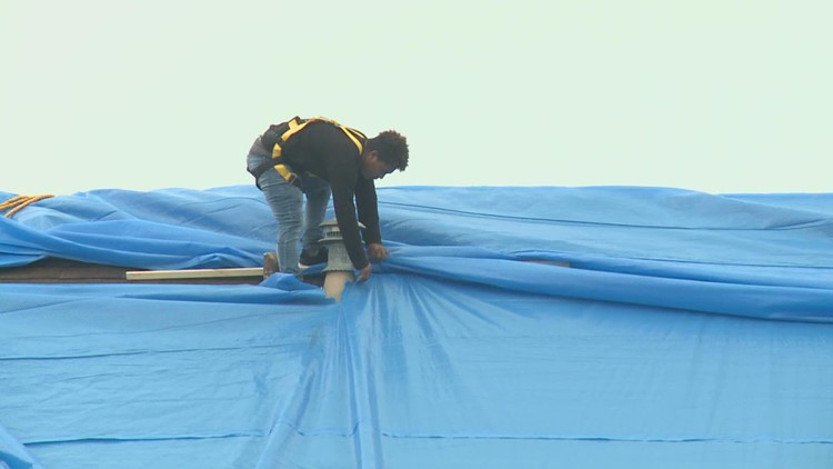 Concerned Louisiana residents wait for roof repairs as Tropical Storm Nicholas heads their way