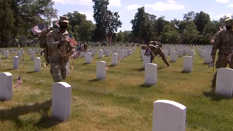 Service members place flags at Arlington National Cemetery