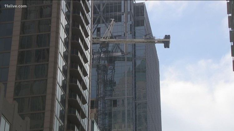 Unstable crane in jeopardy of falling in Midtown Atlanta; Engineers in route to assess the situation