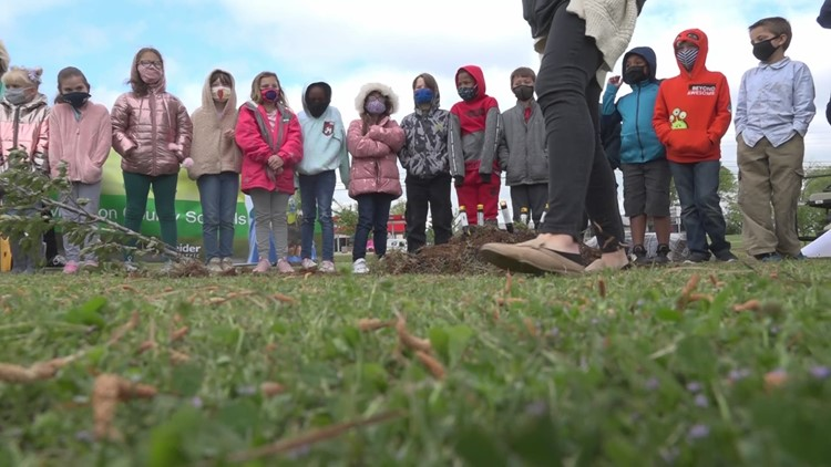 Earth Day is tomorrow; local school plants trees to celebrate.