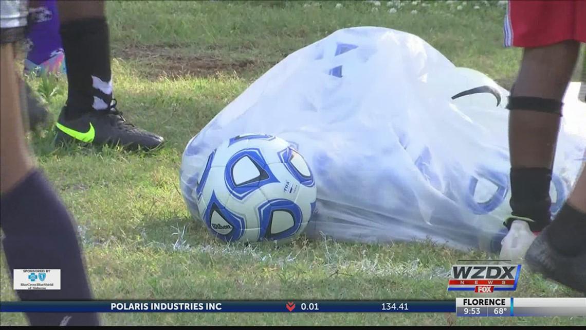 Huntsville Sports Commission donate soccer balls to local Boys & Girls Club